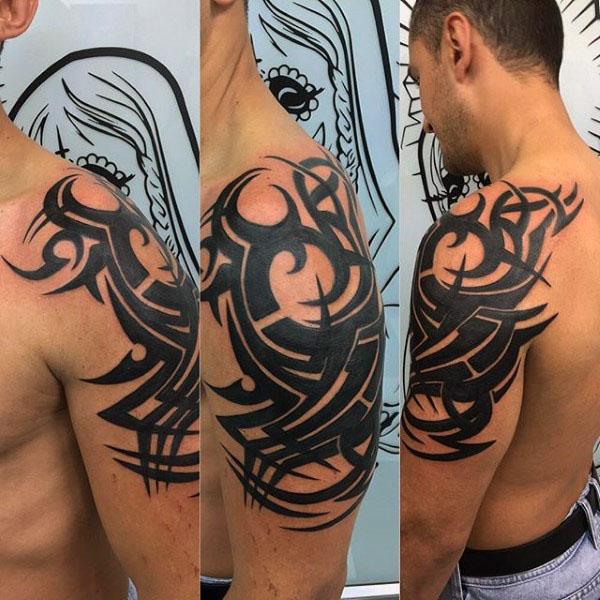 75 Tribal Arm Tattoos für Männer - Interwoven Line Design-Ideen