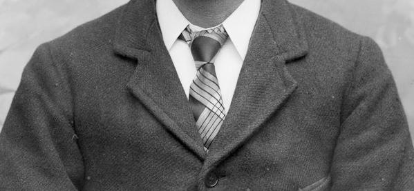 Die Anleitung für das Tragen der Krawattenklammern der Männer mit Stil