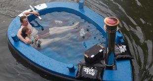 Der Hot Tug-ein Whirlpool-Boot ist ein Holzfeuer Schwimmdock Jacuzzi